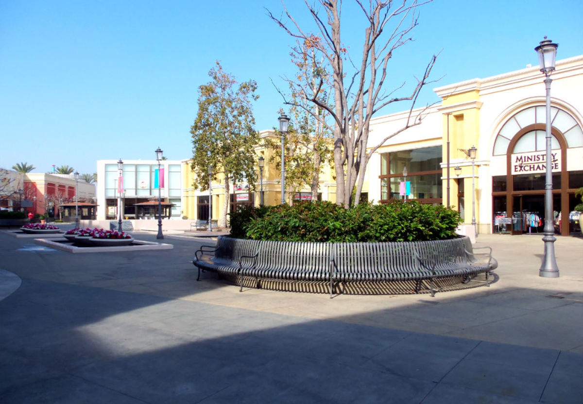 "- ""Shadow Encroachment"" - A ""Park Bench in the Round"" along with a selection of specialty shops accentuate the quaint common area adjacent to the ""Krikorian Movie Theater"" - A perfect place to meet & engage friends, family members, & acquaintances -"