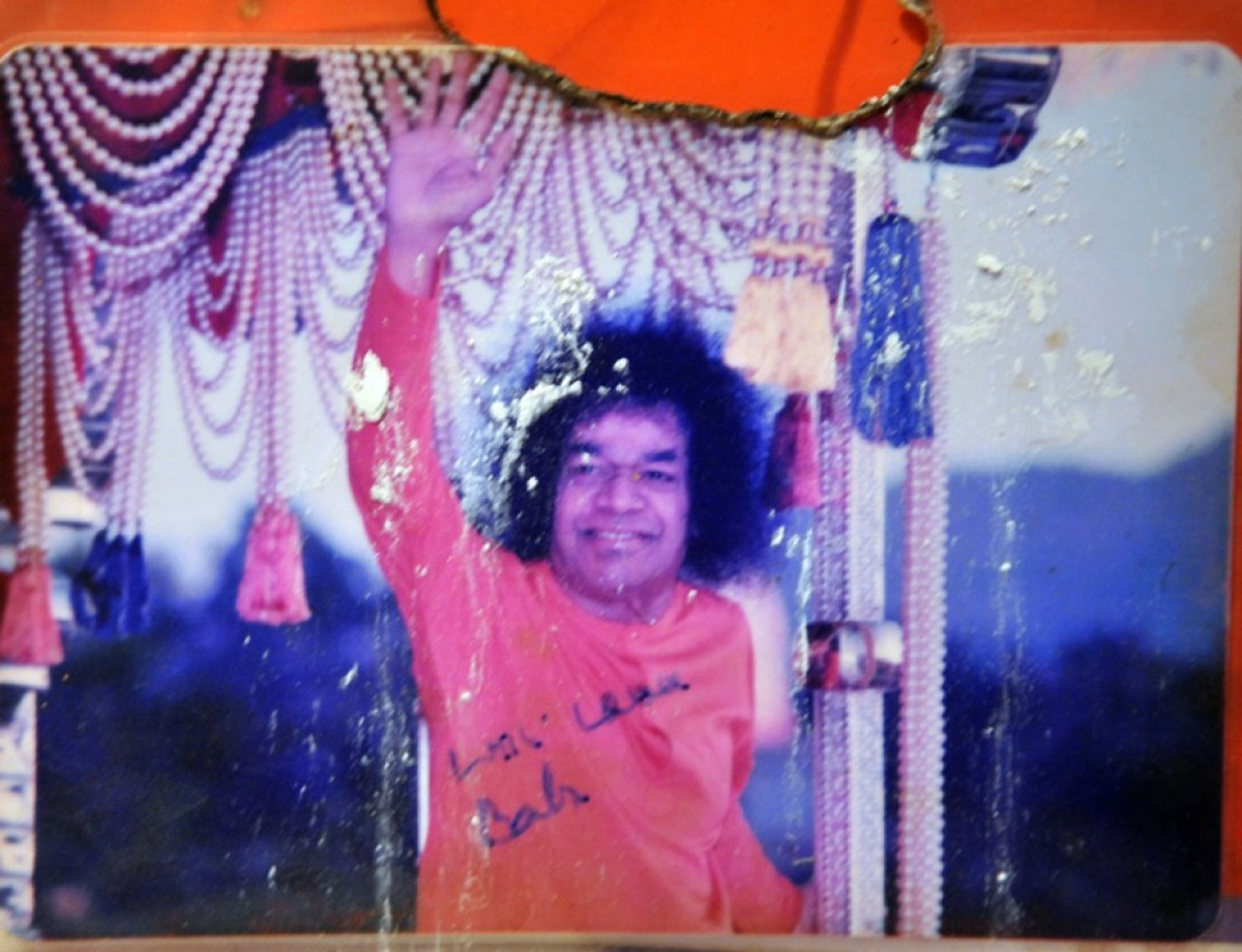 The photo which Swami signed...which later fell and got burnt...(note that no part of Him has been touched) which had vibhuti appearing on it in March 2012