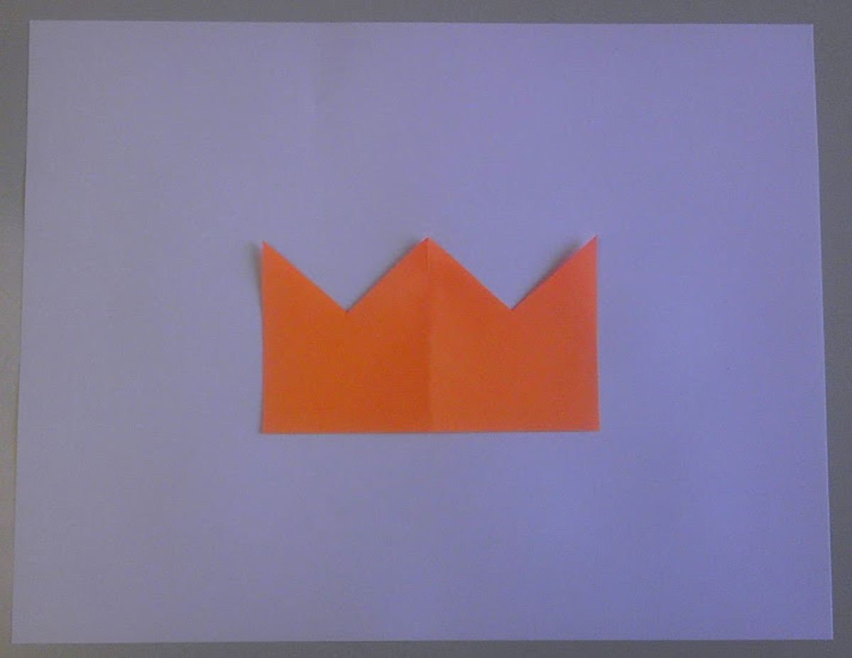 The same four figures arranged to create positive space (a crown).