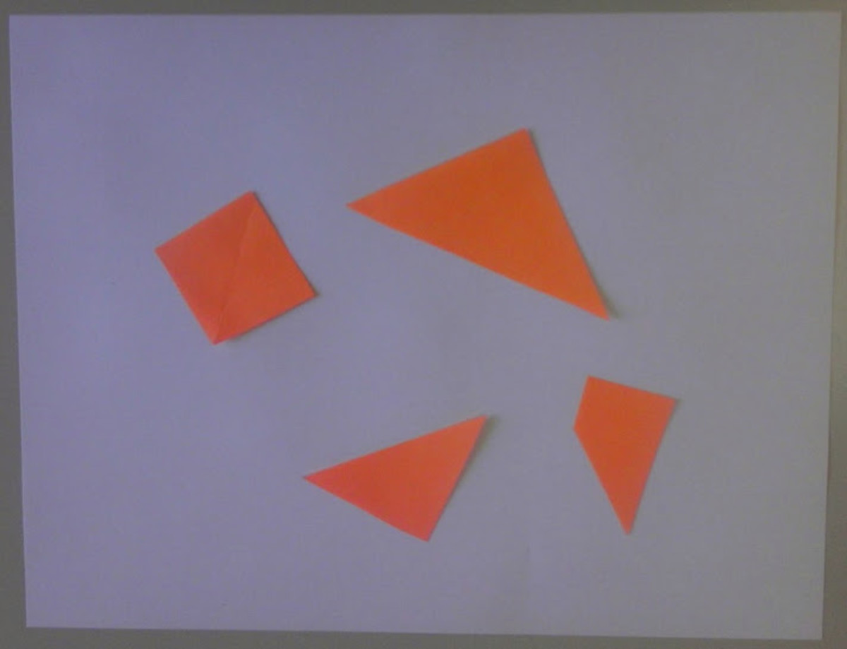 Four figures arranged randomly with the result being negative space.