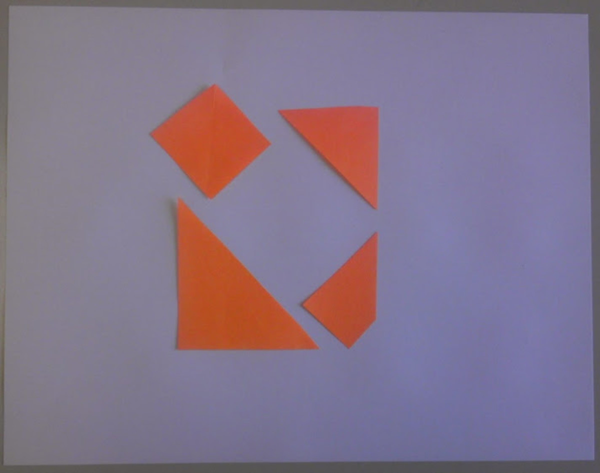 The same four figures arranged to create positive space (a square).
