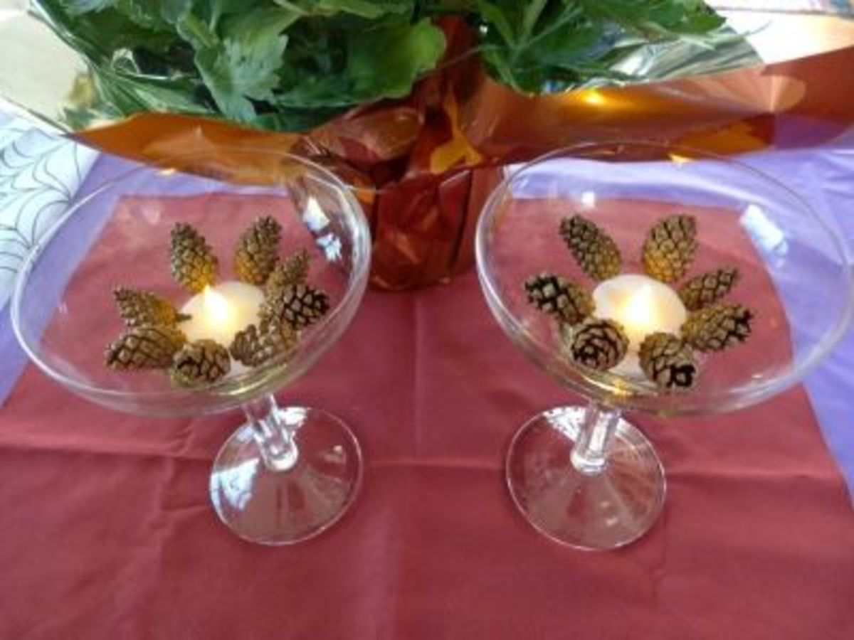 Light up the table with petite Scots pine cones in Margarita glasses