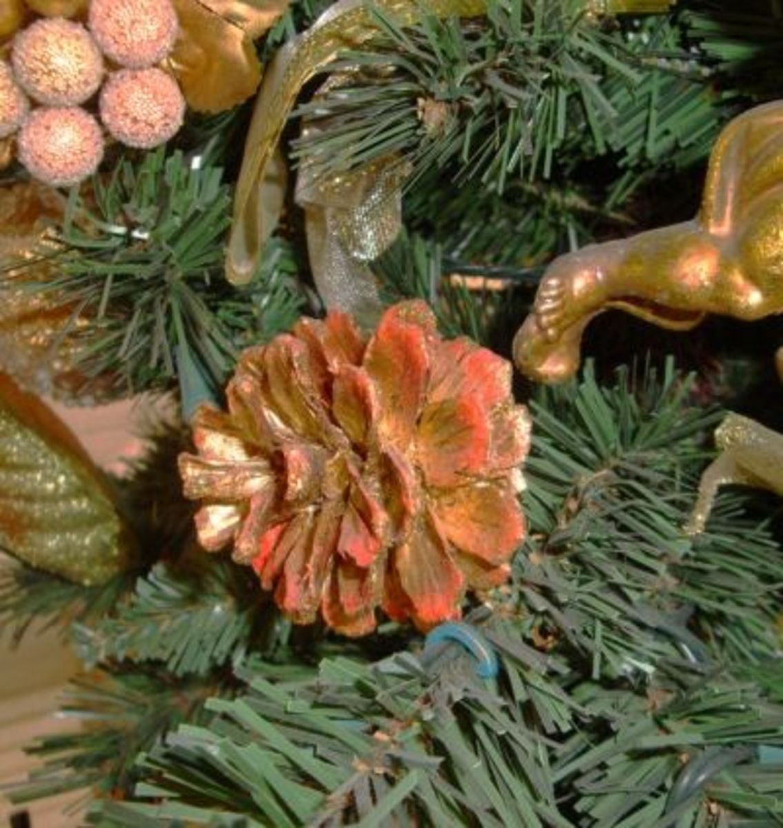 Spray pine cone with glitter paint and adorn a faux Christmas tree