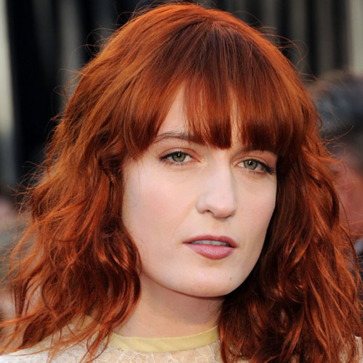 Florence Welch's makeup with red hair and green eyes