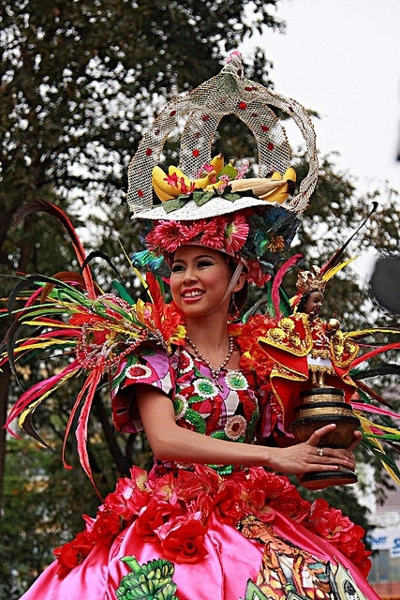 A Beaming Filipina Wearing a Colorful Costume During a Sinulog Festival, a Philippine Fiesta