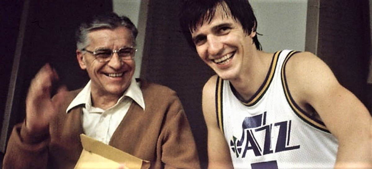 Finally able to just enjoy each other's company, Dad and son share a post game laugh in the New Orleans locker room.