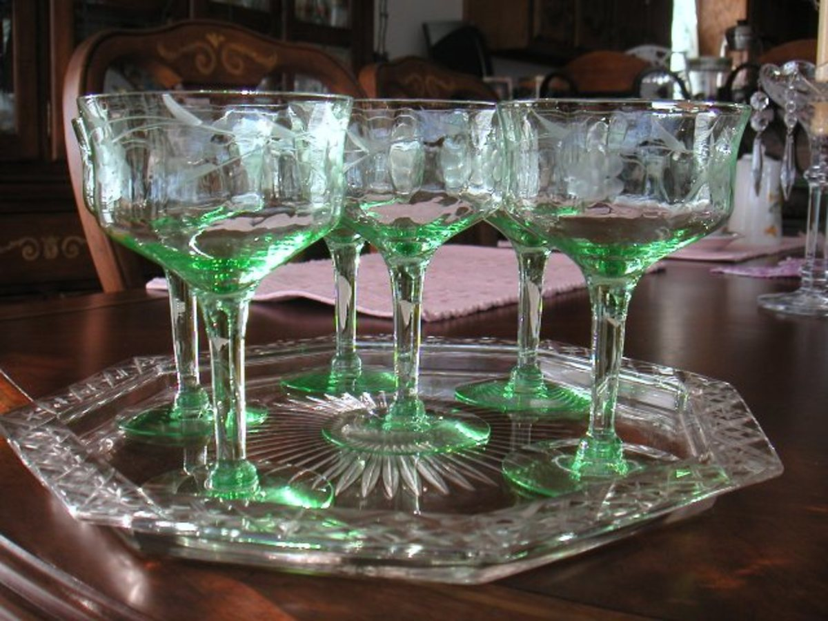 Etched green glass goblets from the depression era from a Thrift store
