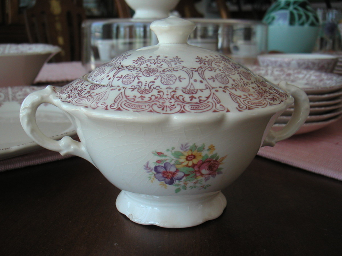 Sugar bowl in the Burgundy Lace pattern from the nineteen forties by French Saxon is difficult to find.