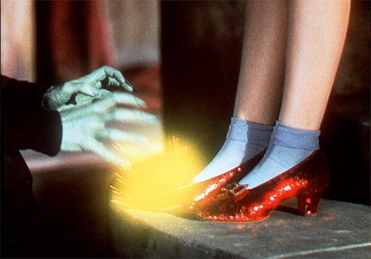 Wizard of Oz ruby red slippers and the green witches hands being repelled by the power of the slippers