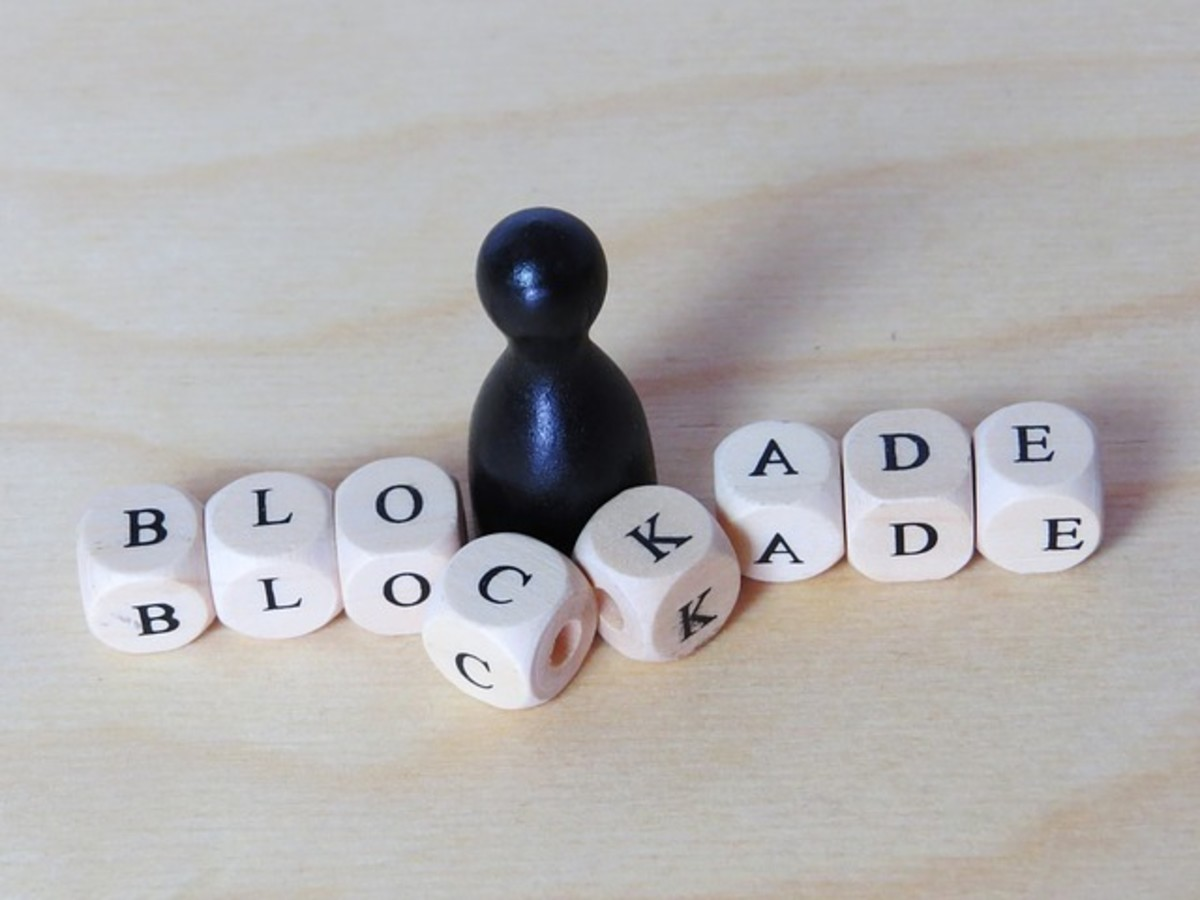 "Blockaee spelled out with a chest rook blocking the letters of ""blockade"""