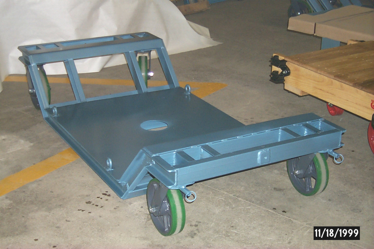 Custom Low Profile Dolly with clearance hole, pad eyes and a threaded lug to allow attaching to a pulling mechanism.