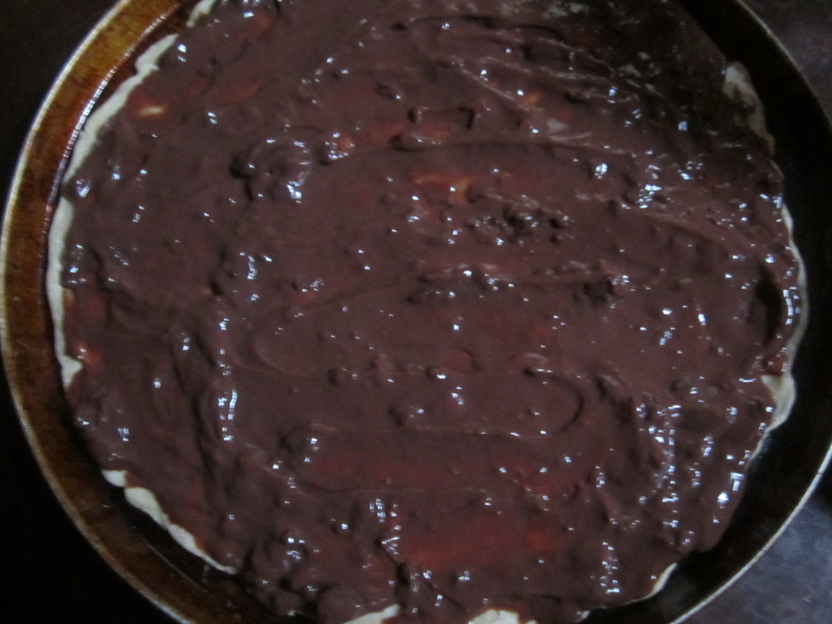 Spread chocolate pudding on top of crust after it has baked a few minutes.