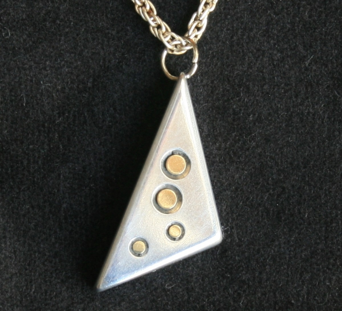 Aluminium and brass pendant