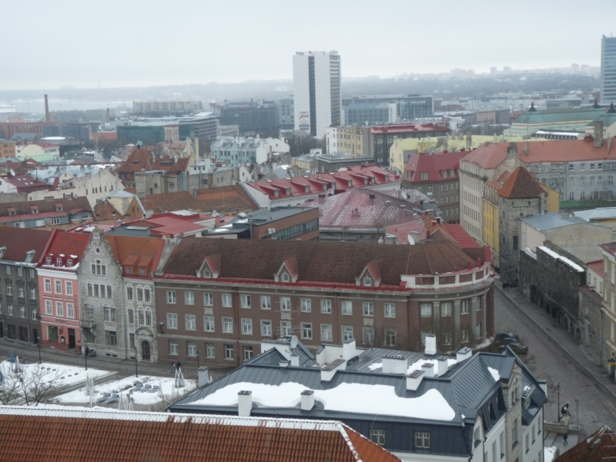 Tallinn old town. The brown building in center with 3 gables and curved corner with columns houses Estonia's Ministry of Economic Affairs and Communications.