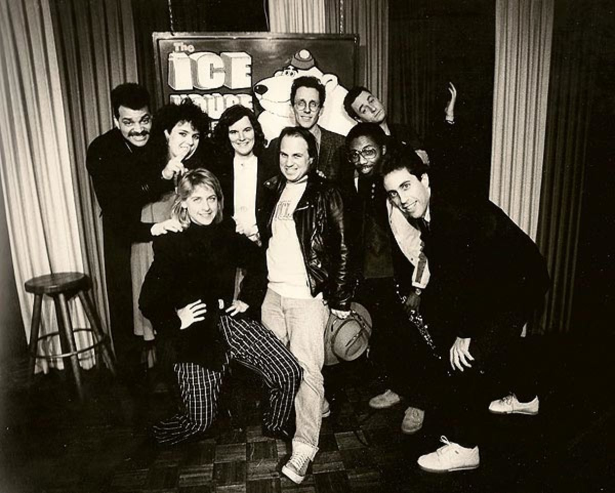 Front Row from left: Ellen DeGeneres, Bobcat Goldthwait, Franklyn Ajaye and Jerry Seinfeld. Back Row from left: Sinbad, Rosie O'Donnell, Paula Poundstone, Jake Johannsen and Barry Sobel.