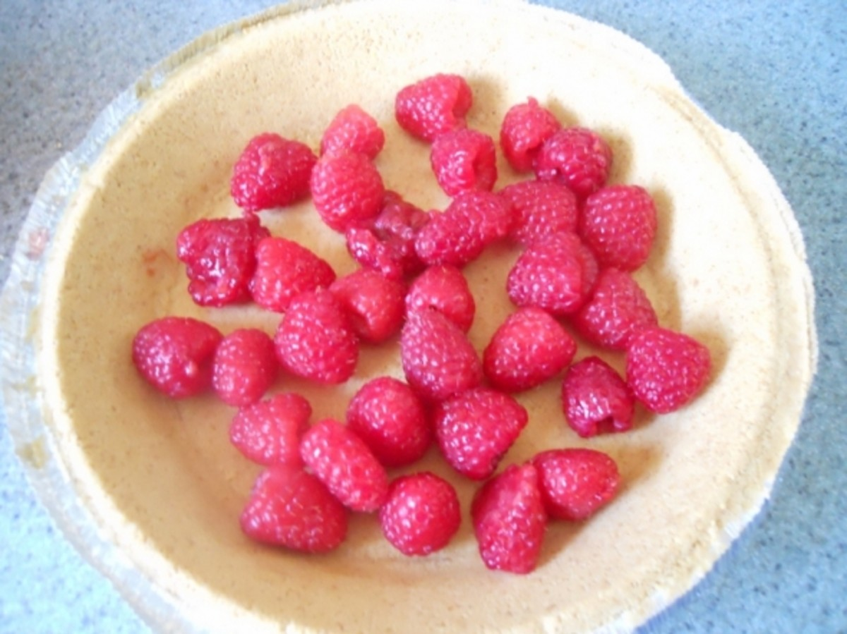 Cleaned, washed, drained raspberries in graham cracker crust.