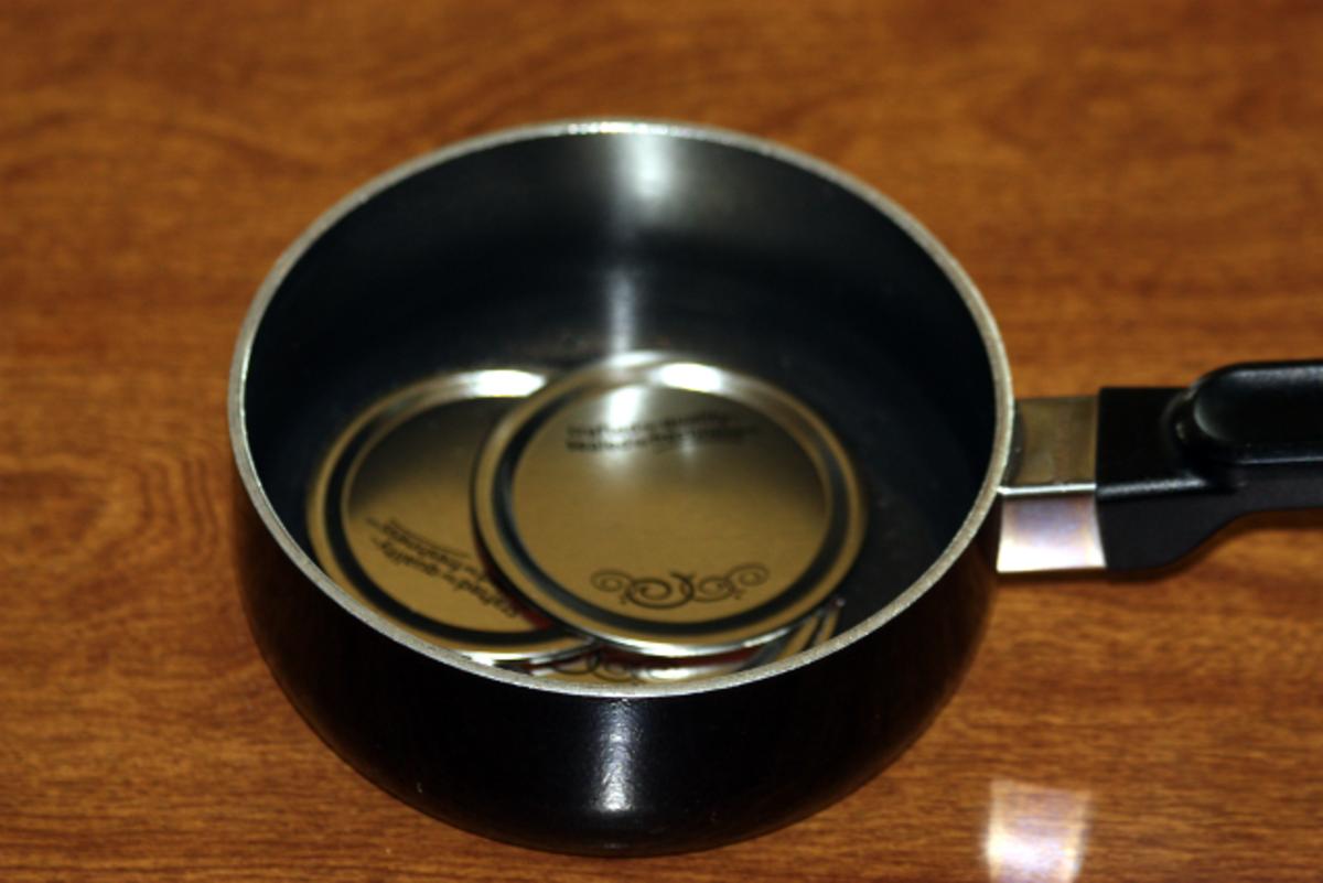 Lids in Pan of Hot Water