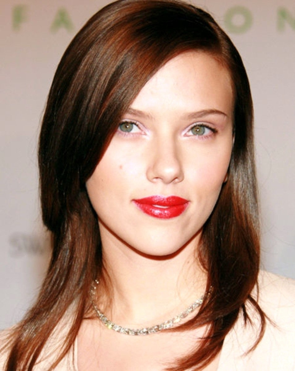 Scarlett Johansson wears long, straight brown hair. Celebrities with chocolate brown hair color.