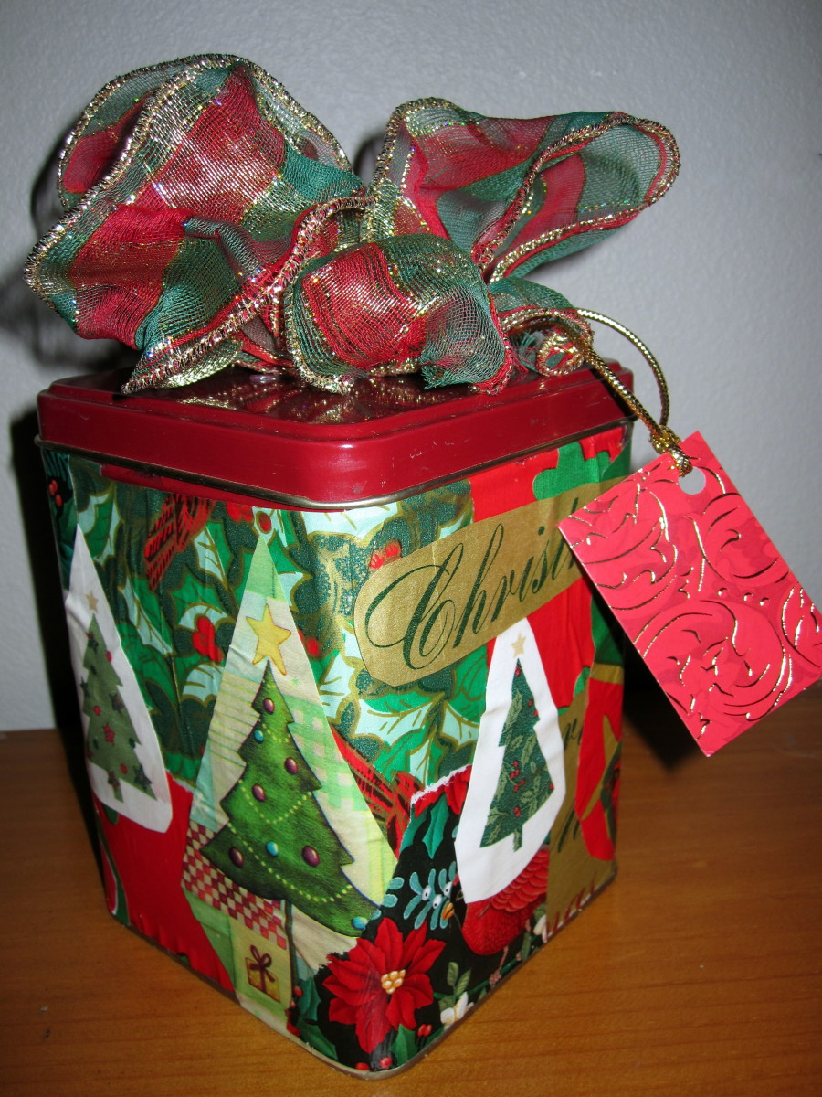 Decoupage tin containers: Using recycled materials to make gift boxes