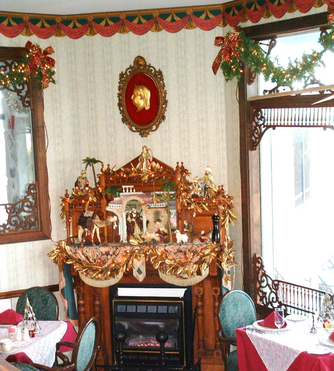 The lowest level of Victoria's has a corner fireplace. The hearth in this picture is decorated for the Christmas and New Year's holidays. Decorations change depending on the holiday and season.