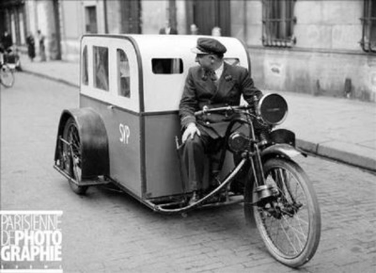 Electric powered taxicab. Paris 1941. Creativity is always at its highest level in times of crisis. Copyright LAPI/Roger-Viollet