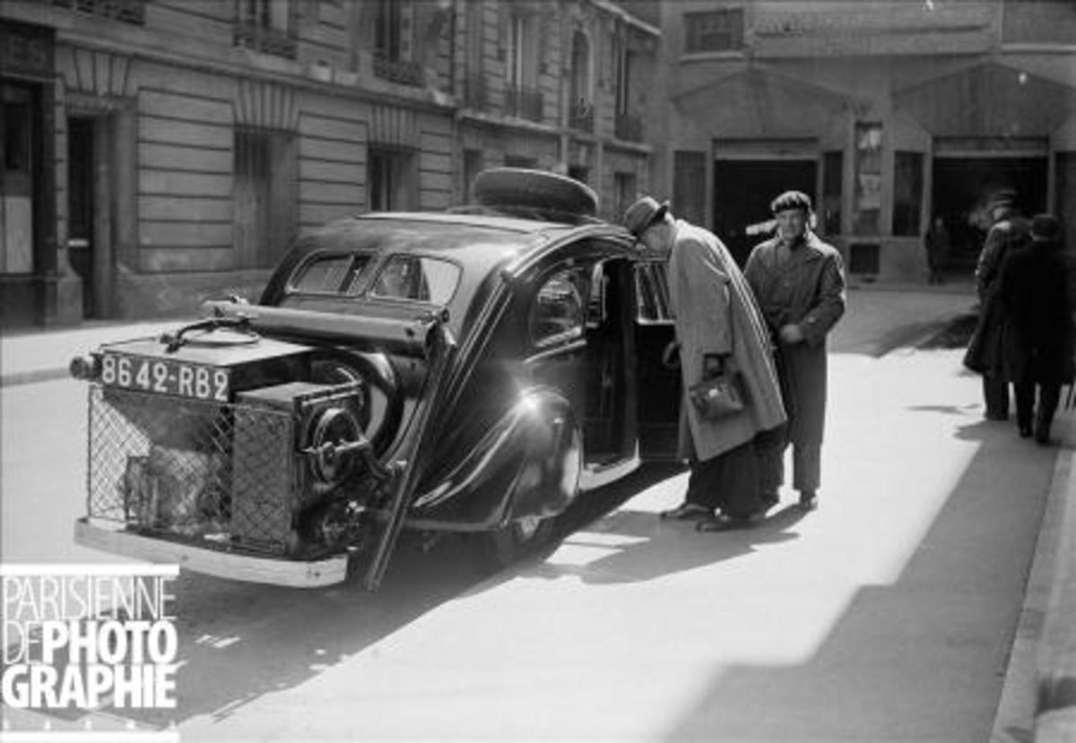 Paris, 1941. A Peugoet 402L or 602 converted to gas obtained by wood burning. Copyright LAPI/Roger-Viollet