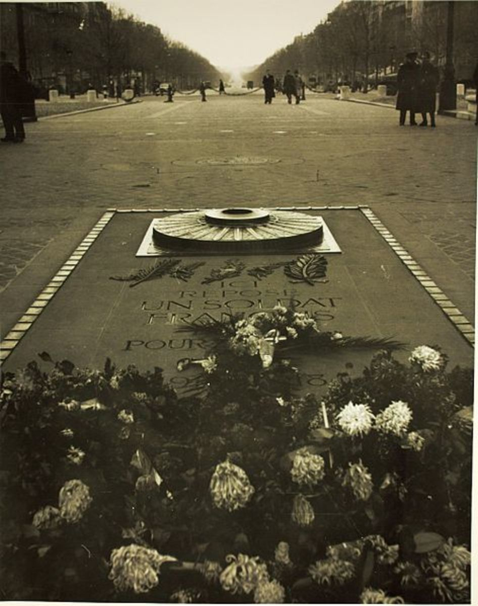 Unknown soldier tomb, located right under the Arc de Triomphe monument. This particular picture shows a perspective of the Avenue des Champs Elysees, all the way down to Place de la Concorde. C.1941