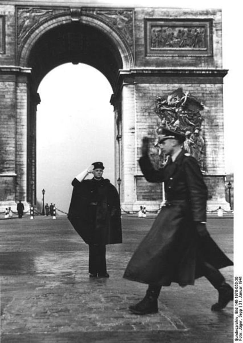 January 31, 1941. French policeman (wearing cape) exchanging salute with a German officer in front of the Arc de Triomphe