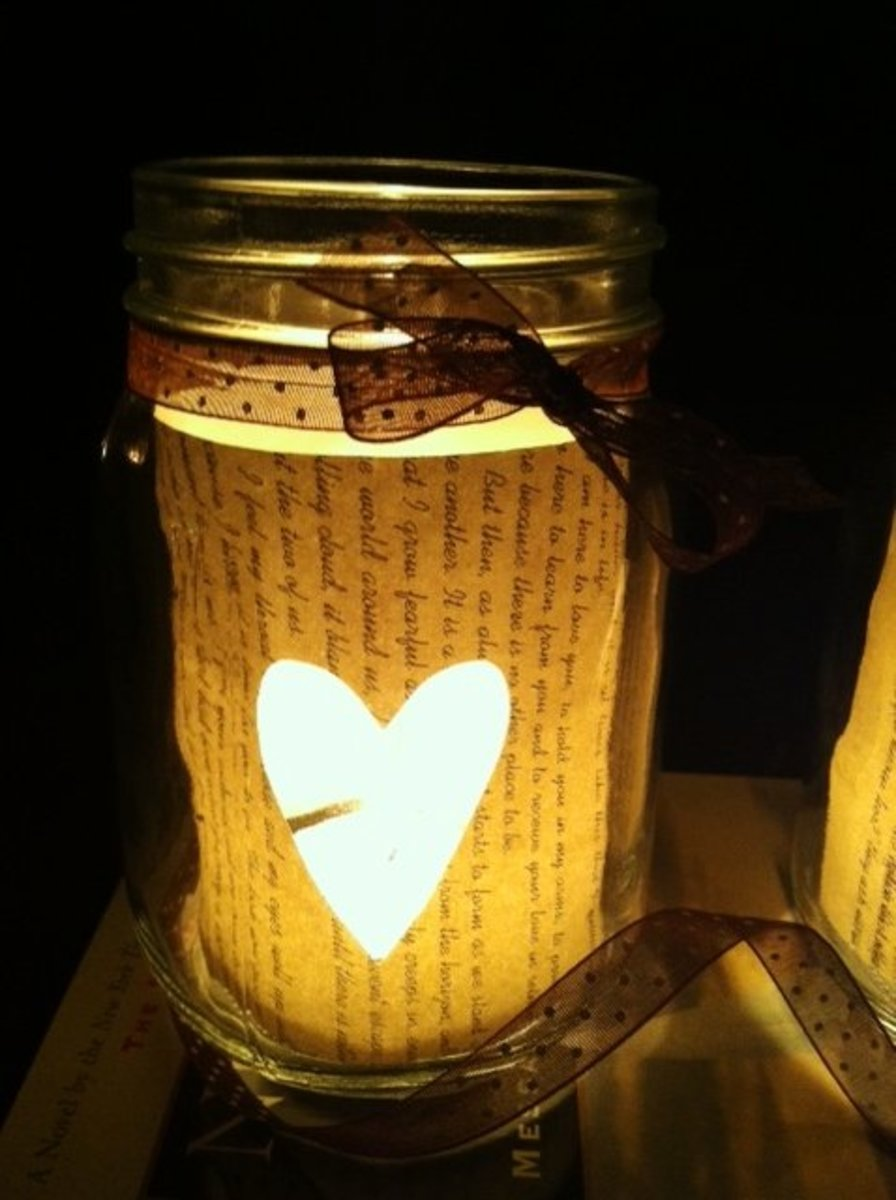 Book page mason jar candle holder, illuminated with a tealight candle.