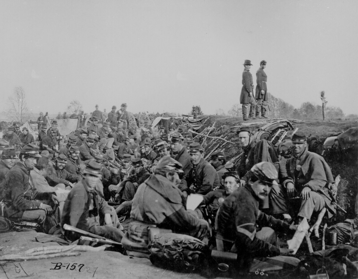 Soldiers hunker down before the next assault