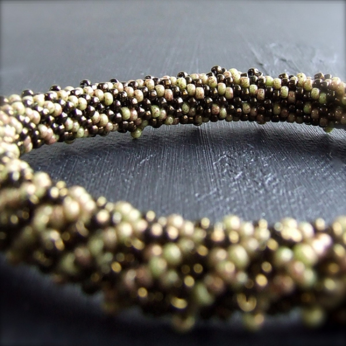 This gorgeous bangle is made up of 12 ft of thread and over 1000 beads!