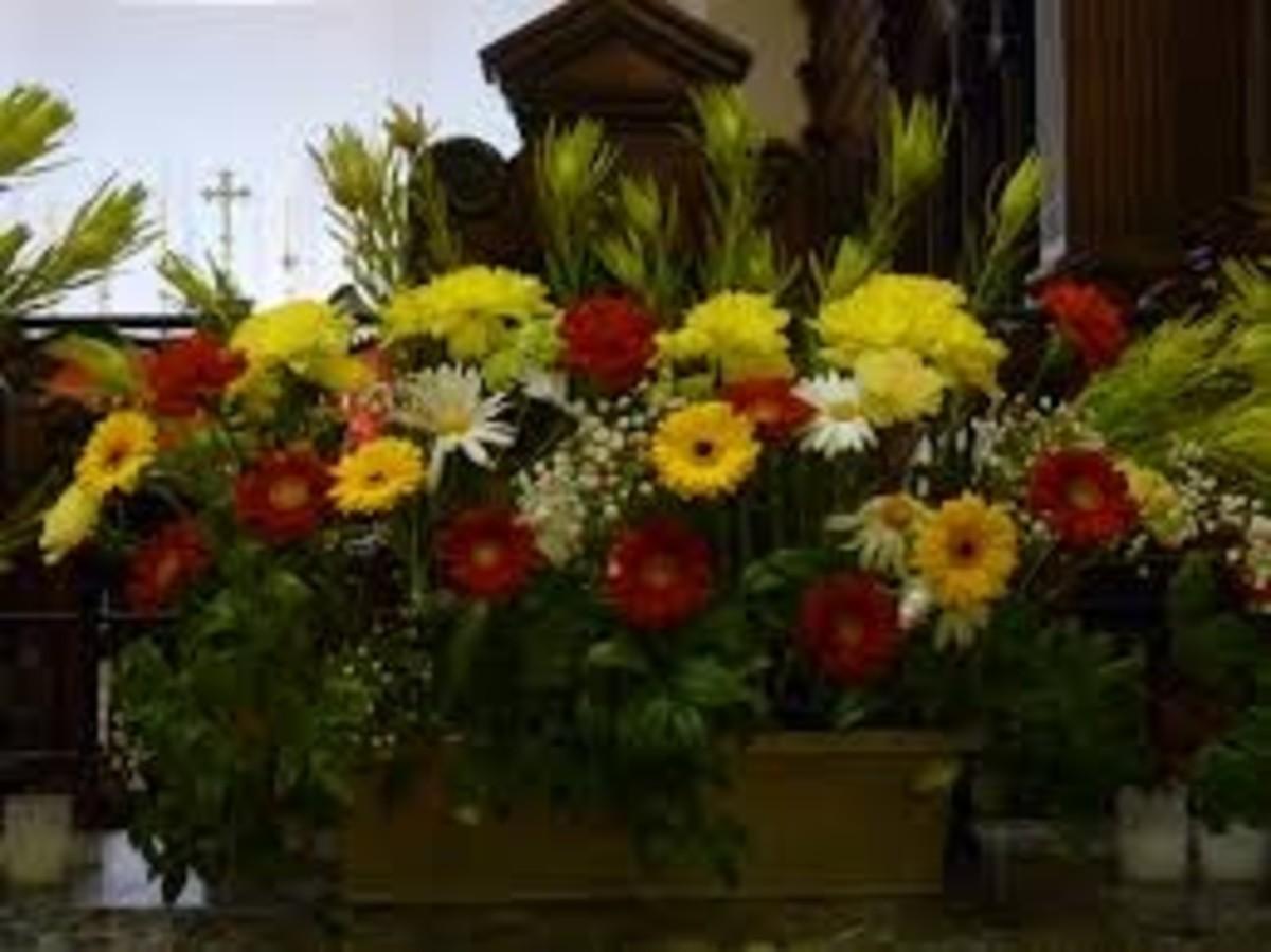 Wedding arrangement on altar at chapel.