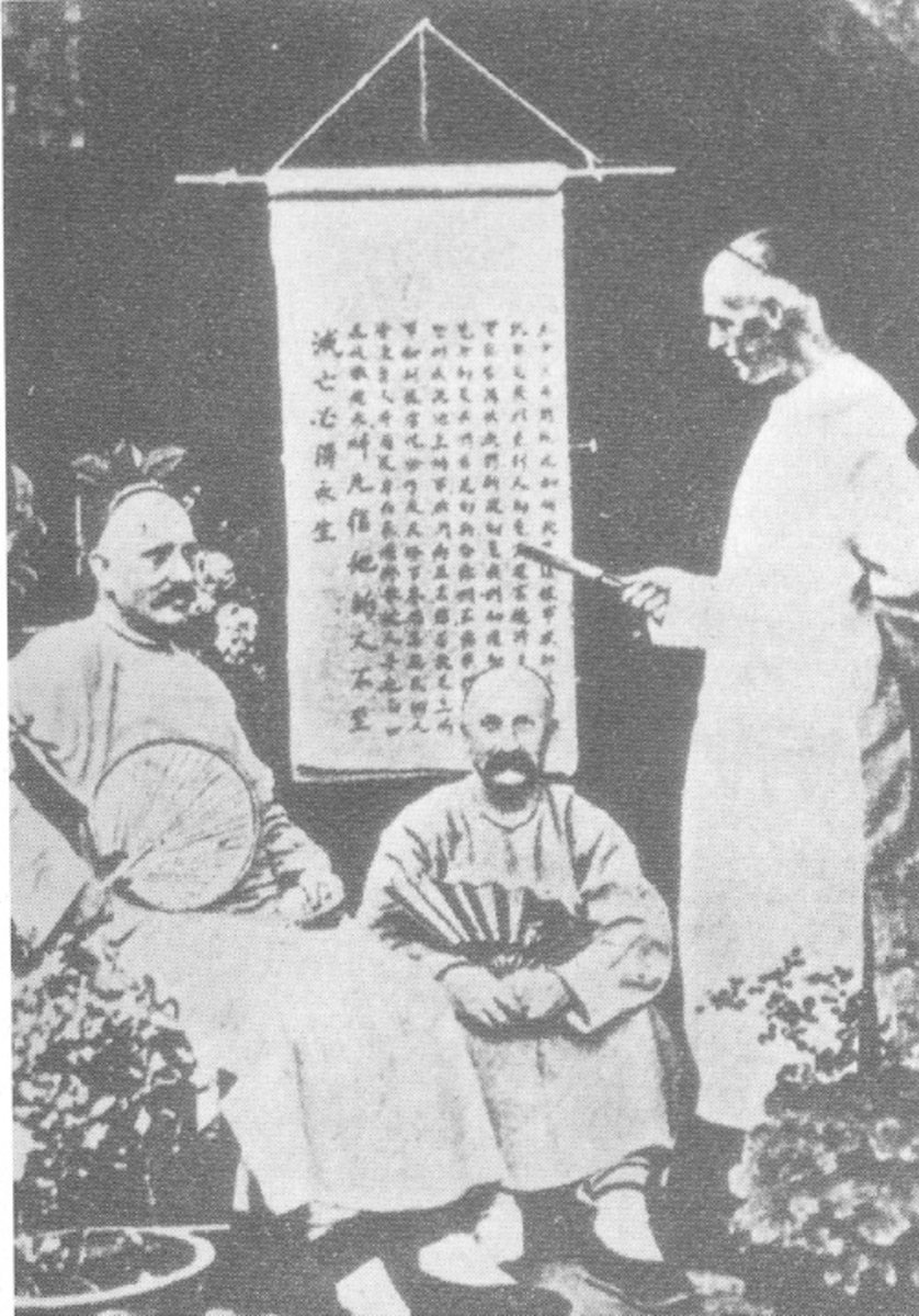 Western Missionaries in China, circa 1900. Note that these missionaries have adopted Chinese dress and appear to be studying Chinese characters.