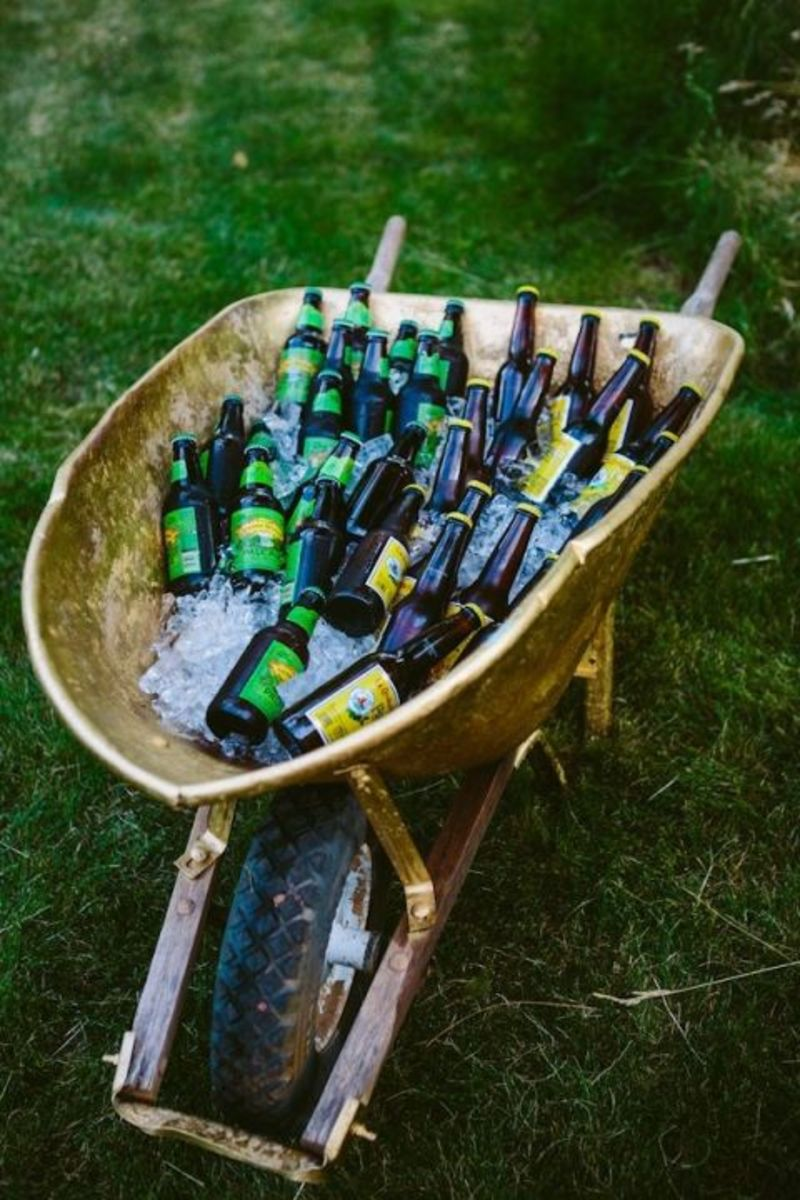 Rustic wedding ideas - old wheelbarrow + ice + beer