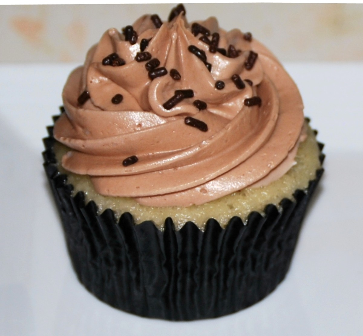 Island Bites: Vanilla Cupcakes with Nutella filling and Nutella Buttercream