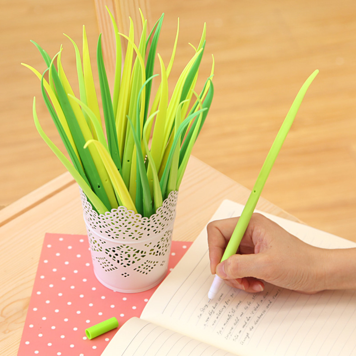 A bunch of leaf-shaped pens in a vase can really freshen up your desk.