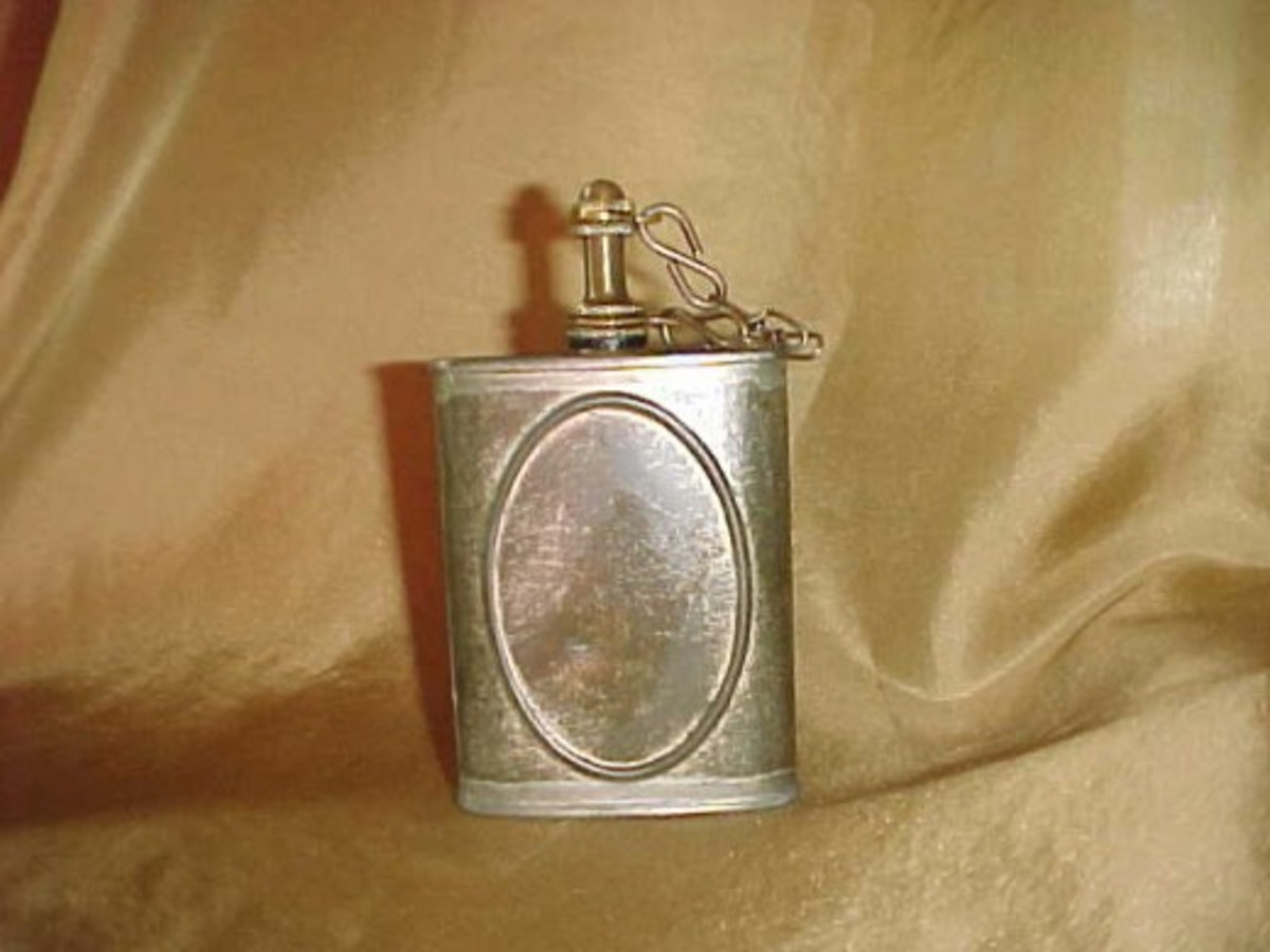 An oil can,; the oil was used on weaponry and accoutrements to protect them against the elements