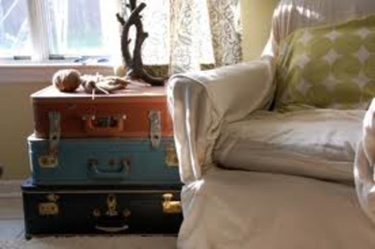 Old mismatched suitcases stacked on end make the perfect end or bedside table.