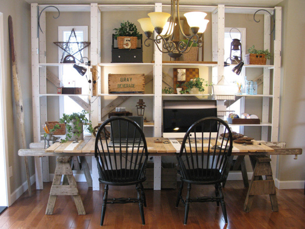 This kitchen table was made using old sawhorses, scaffold boards and a ladder