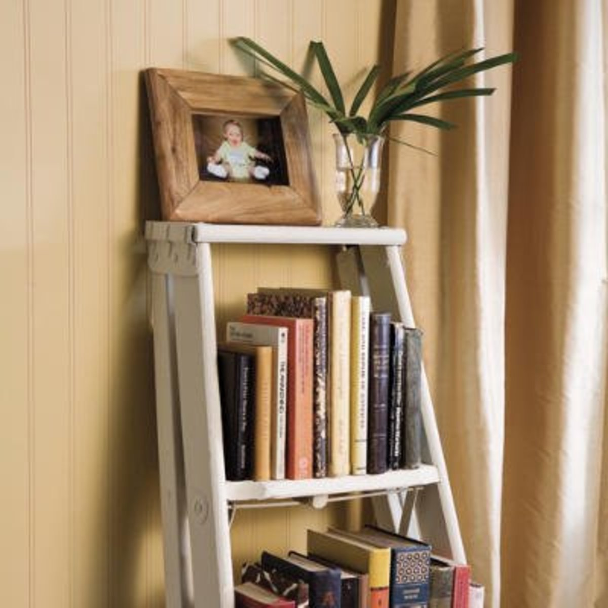 An old stepladder (you may have one lying around in your garage or basement) can be easily converted into a great little bookcase!