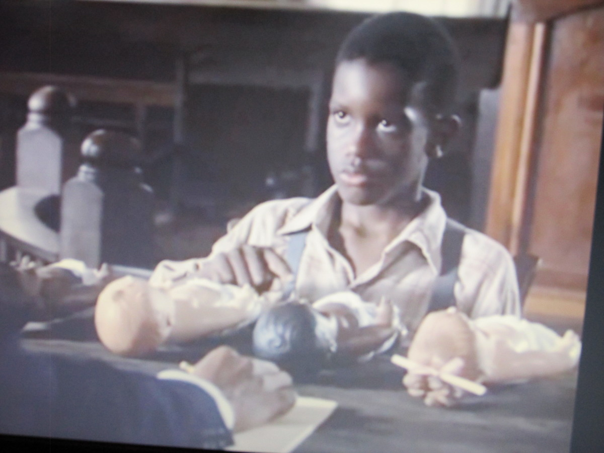 """A black child is given a test within the movie """"Separate But Equal."""" Numerous negro boys and girls selected the white doll to be superior or prettier than the black doll."""
