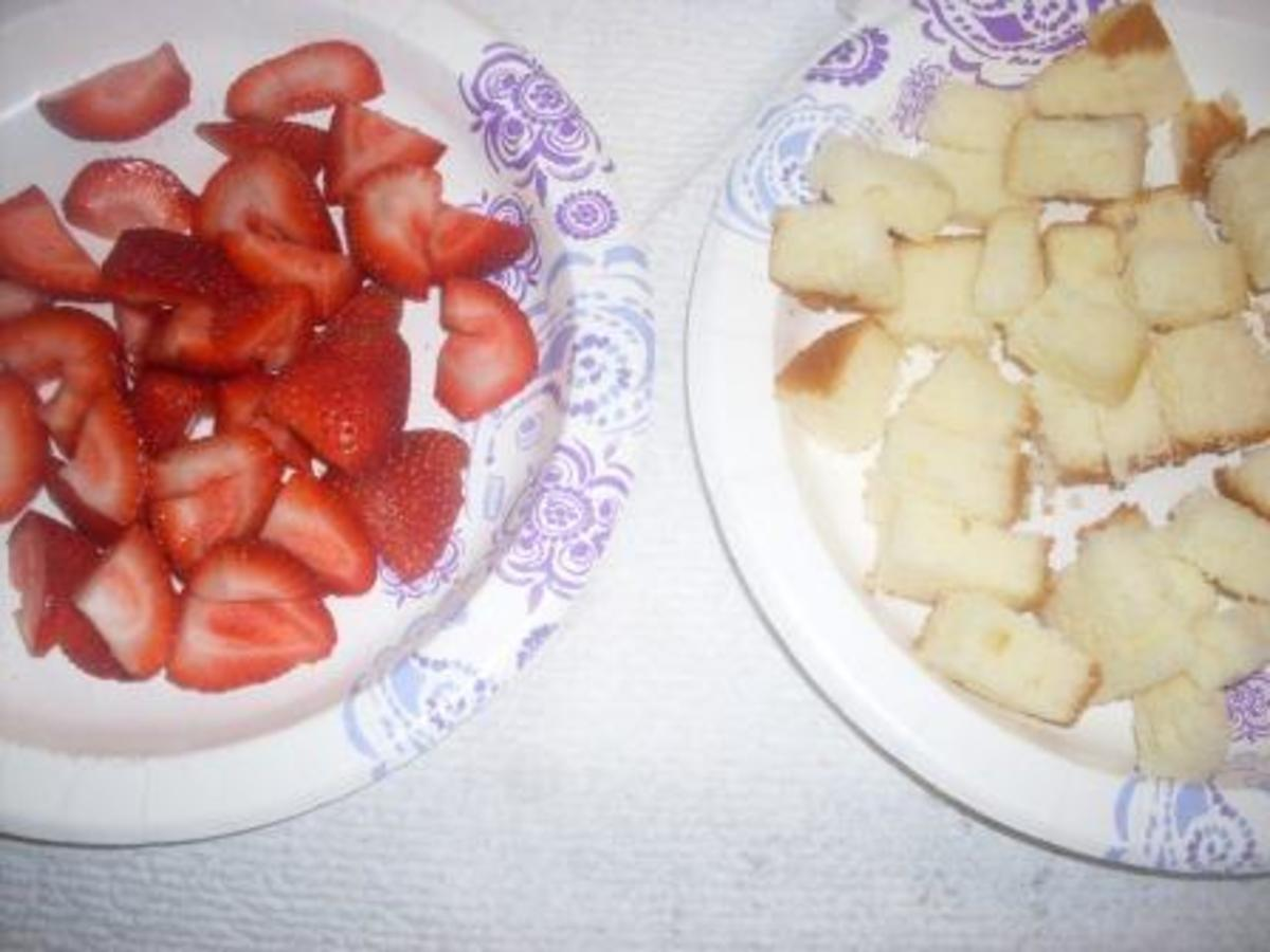 Strawberries and the cake cut into small pieces.