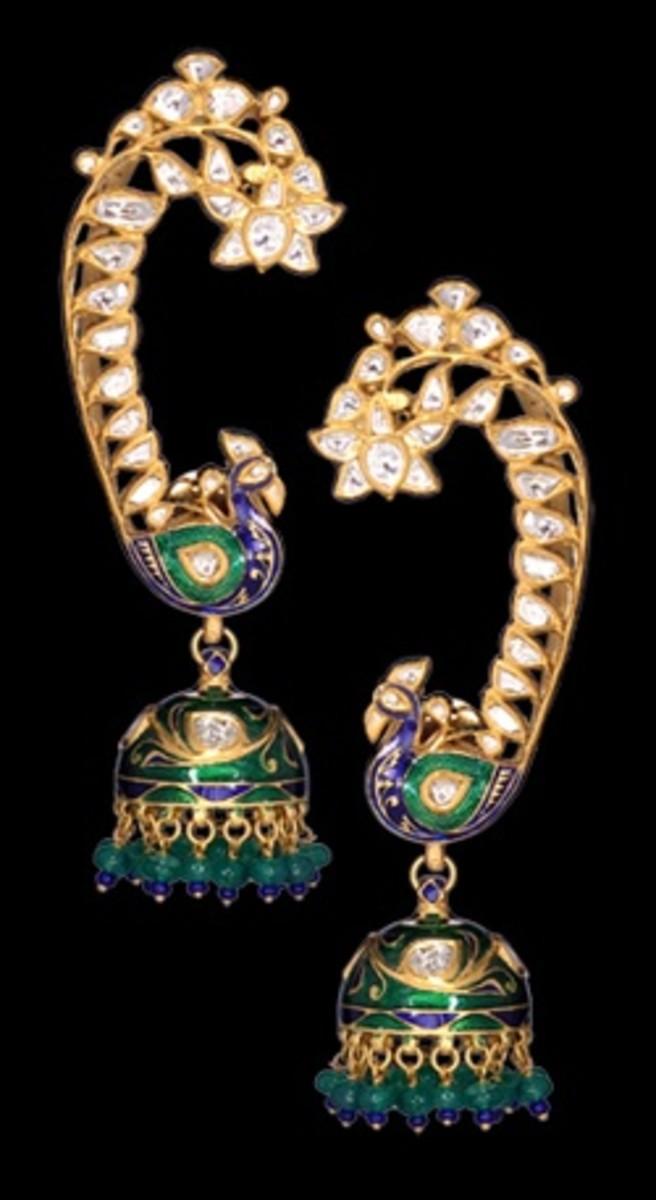 Earring with jhumka. Minakari painting on gold jumka