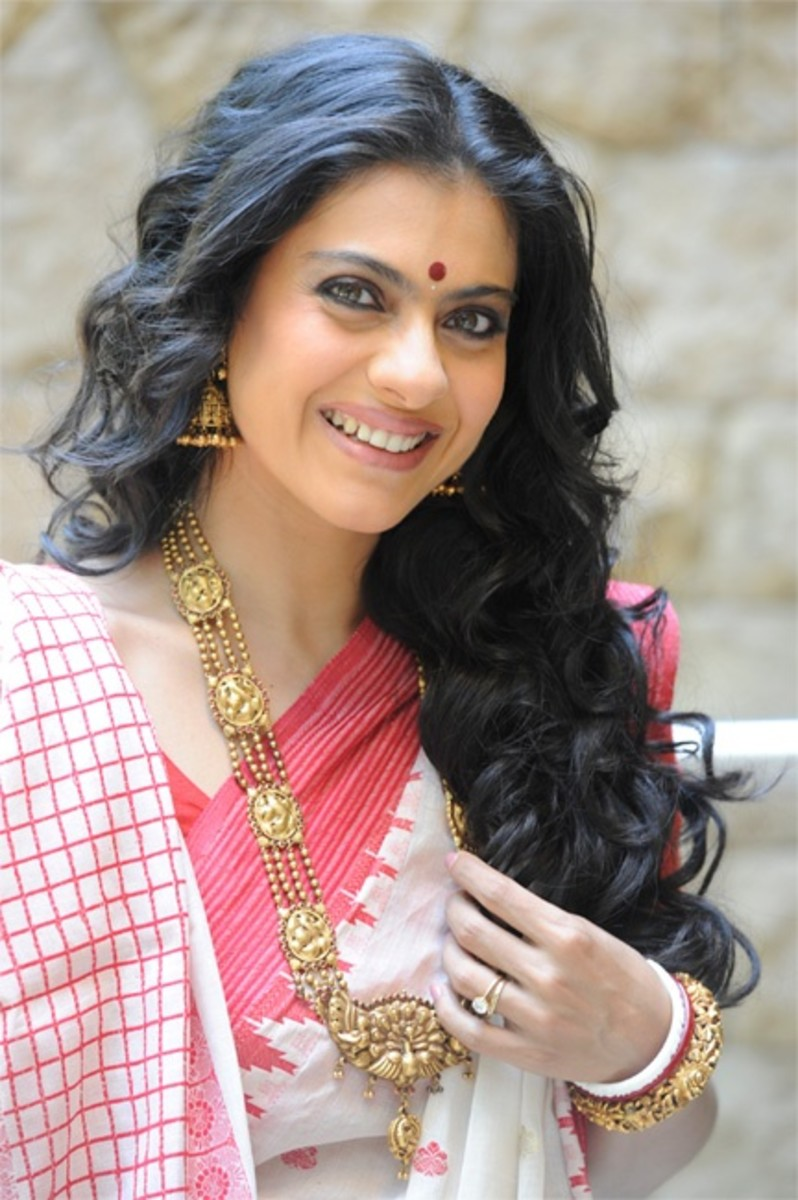 Kajol in traditional saree and temple gold long necklace
