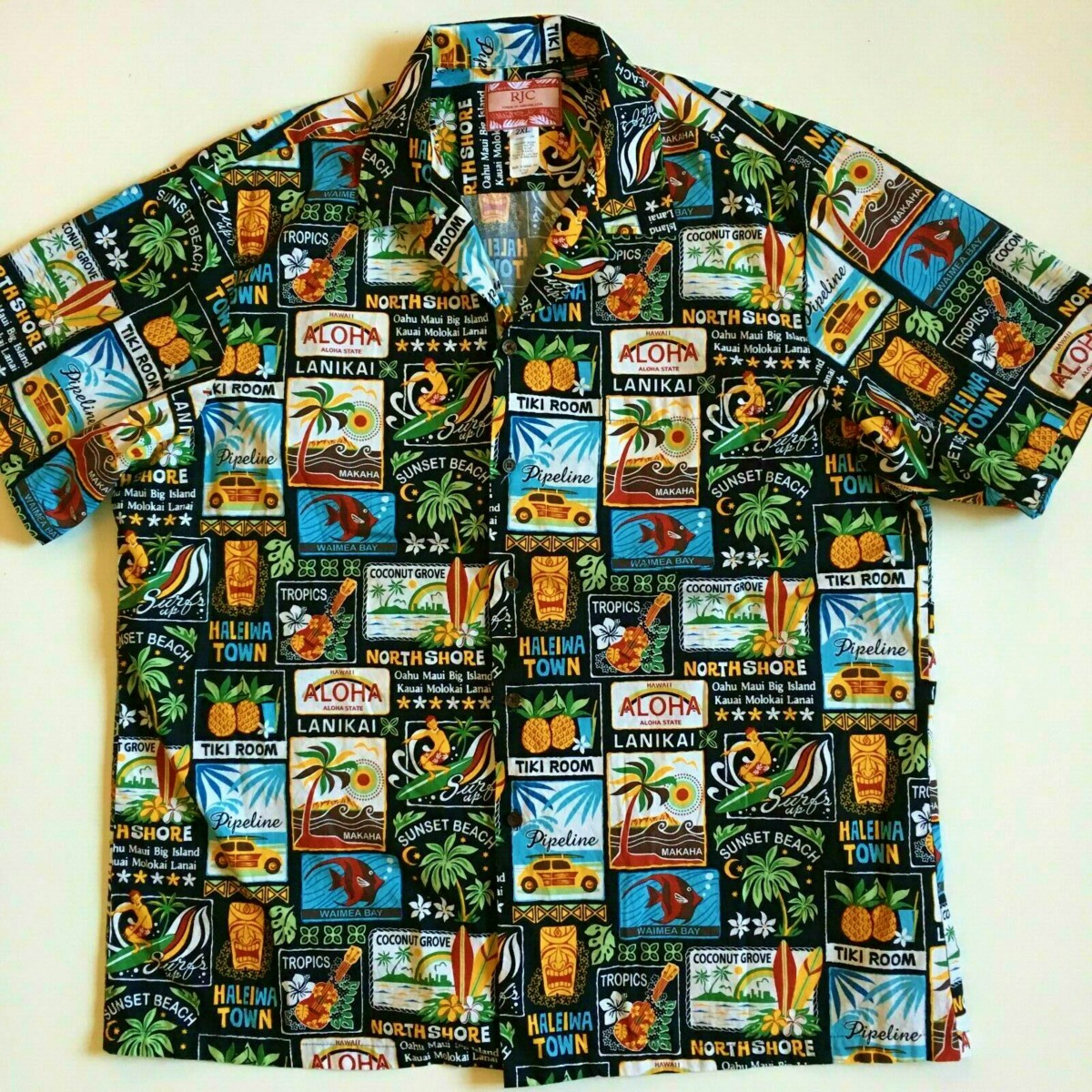 Here is a wonderful mint, RJC USA Men's 2XL Black Tropical Hawaiian Aloha Shirt, and it is 100% Cotton. Made in Hawaii by people who know Hawaiian shirts.