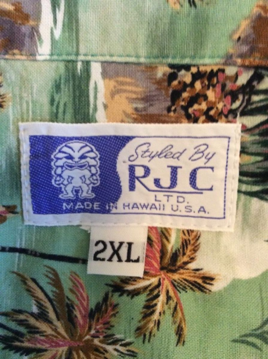Styled by RJC, LTD, and made in Hawaii, with tropical fish, and pom trees blowing in the wind.  It is a true classic Hawaiian shirt.