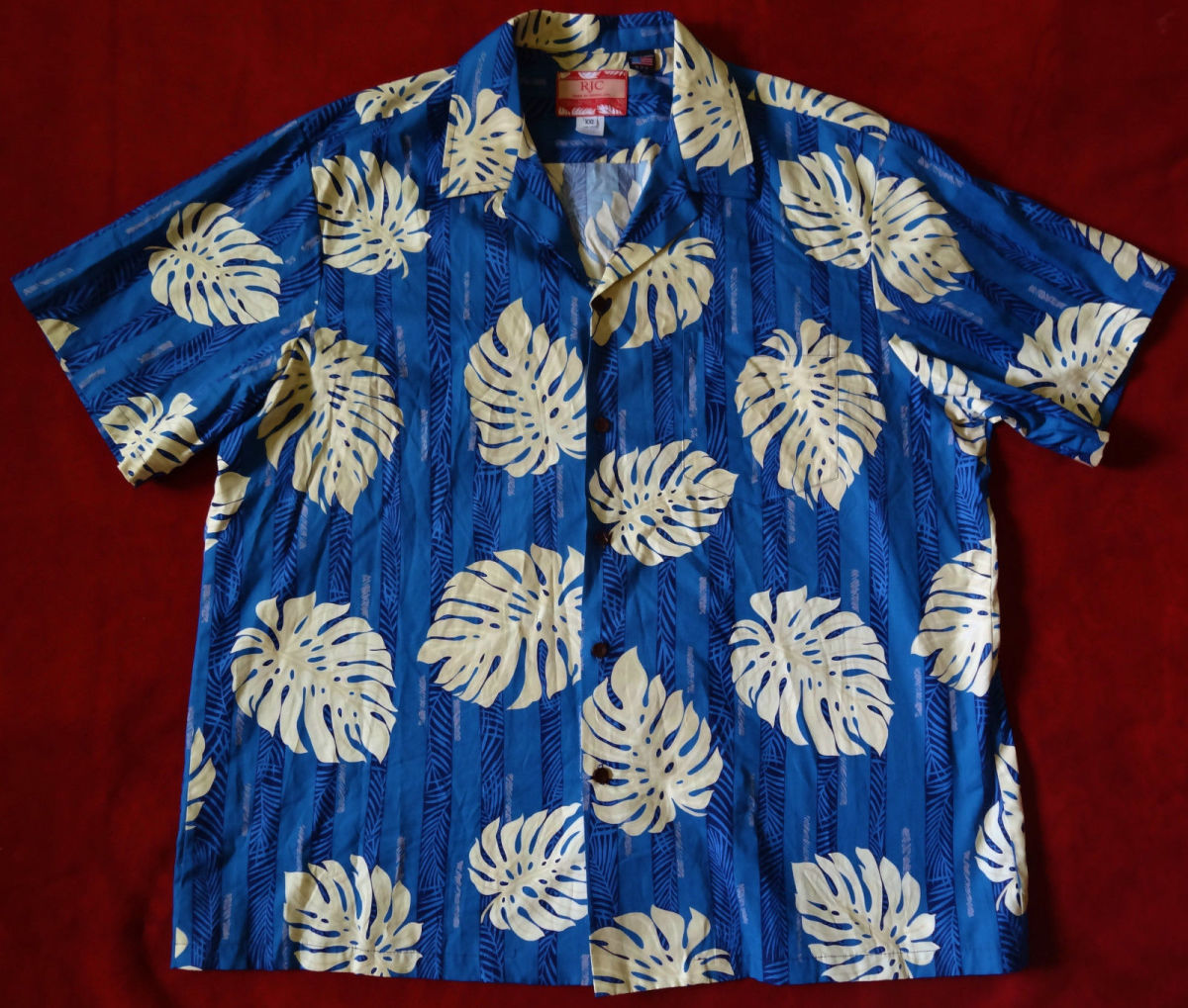 Mens Hawaiian Aloha Shirt from RJC - Made in Hawaii of 100% Cotton. With a beautiful  sea blue color print with Tropical Palm leaves.