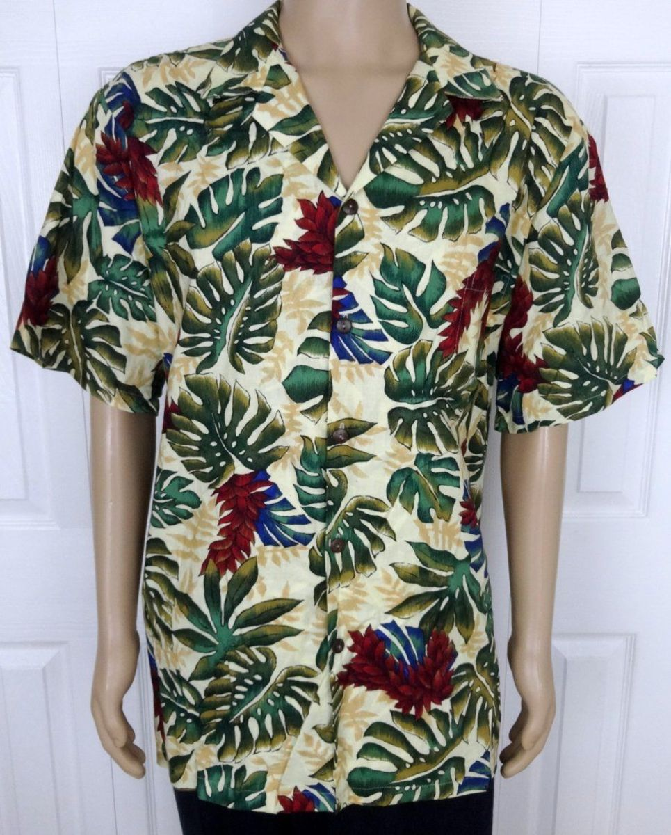Hillo Hattie men's beige short sleeve floral casual Hawaiian shirt, made in Hawaii from imported cotton blend fabric. Original Hawaiian design on this wonderfully made shirt, with real coconut shell buttons.