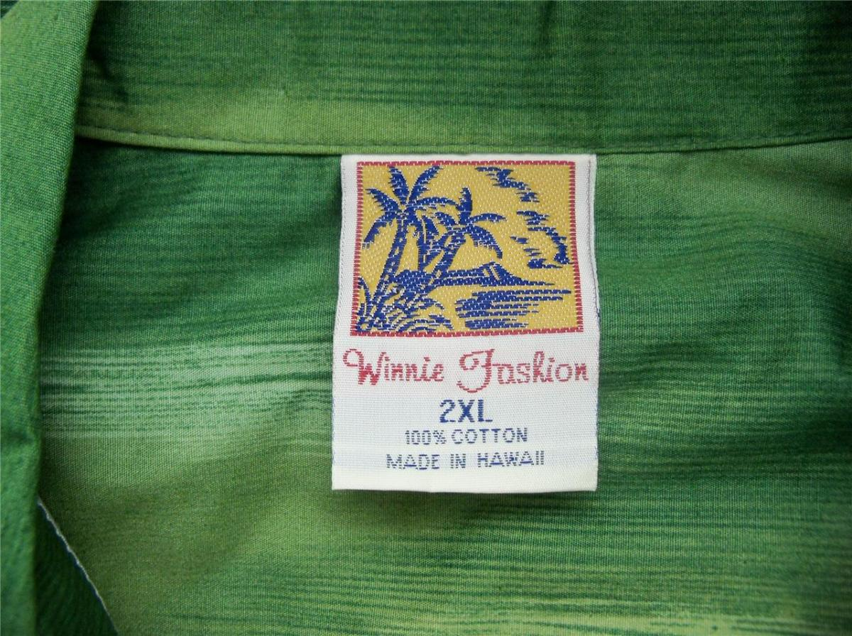 The outrigger in this print helps make this shirt a work of art. You can even see the pride in the shirt tag.