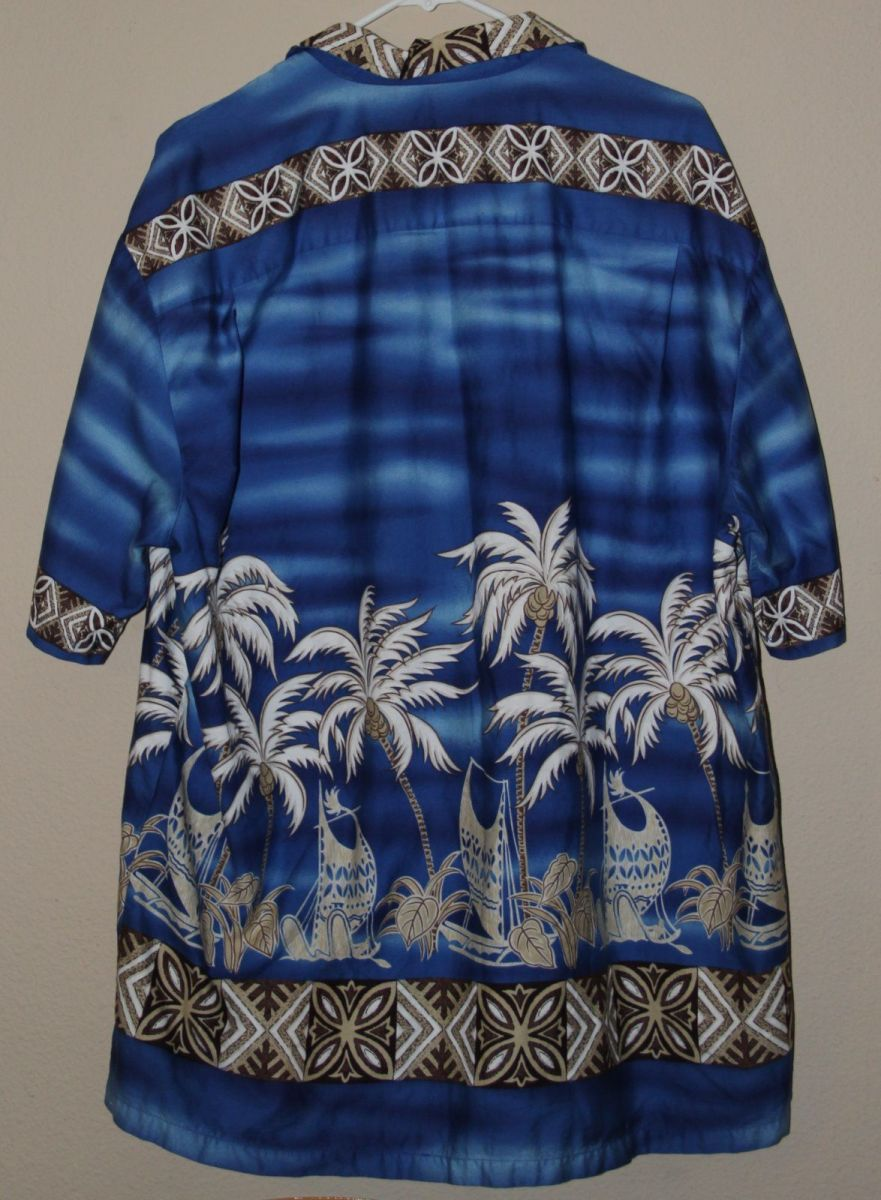 This is a marvelous tribal print WINNIE FASHION made in Hawaii shirt.